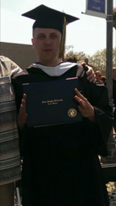 William Miko - Today's Face of Recovery - pictured here receiving this Bachelor's degree diploma.